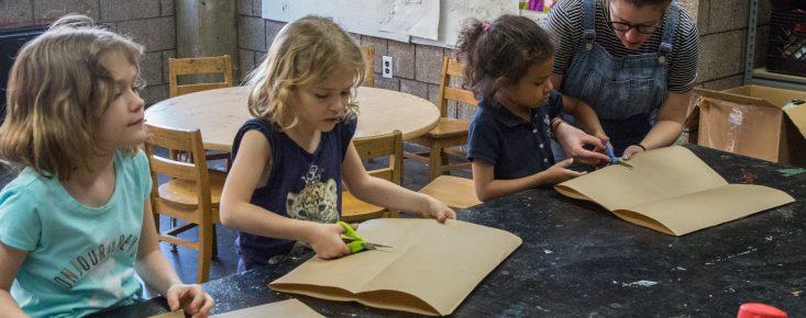 Children take an art class