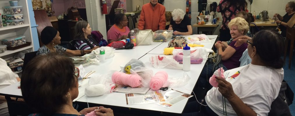 Neighborhood participants of sewing class at Home Planning Workshop