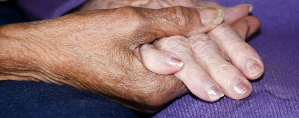 Close-up of seniors holding hands