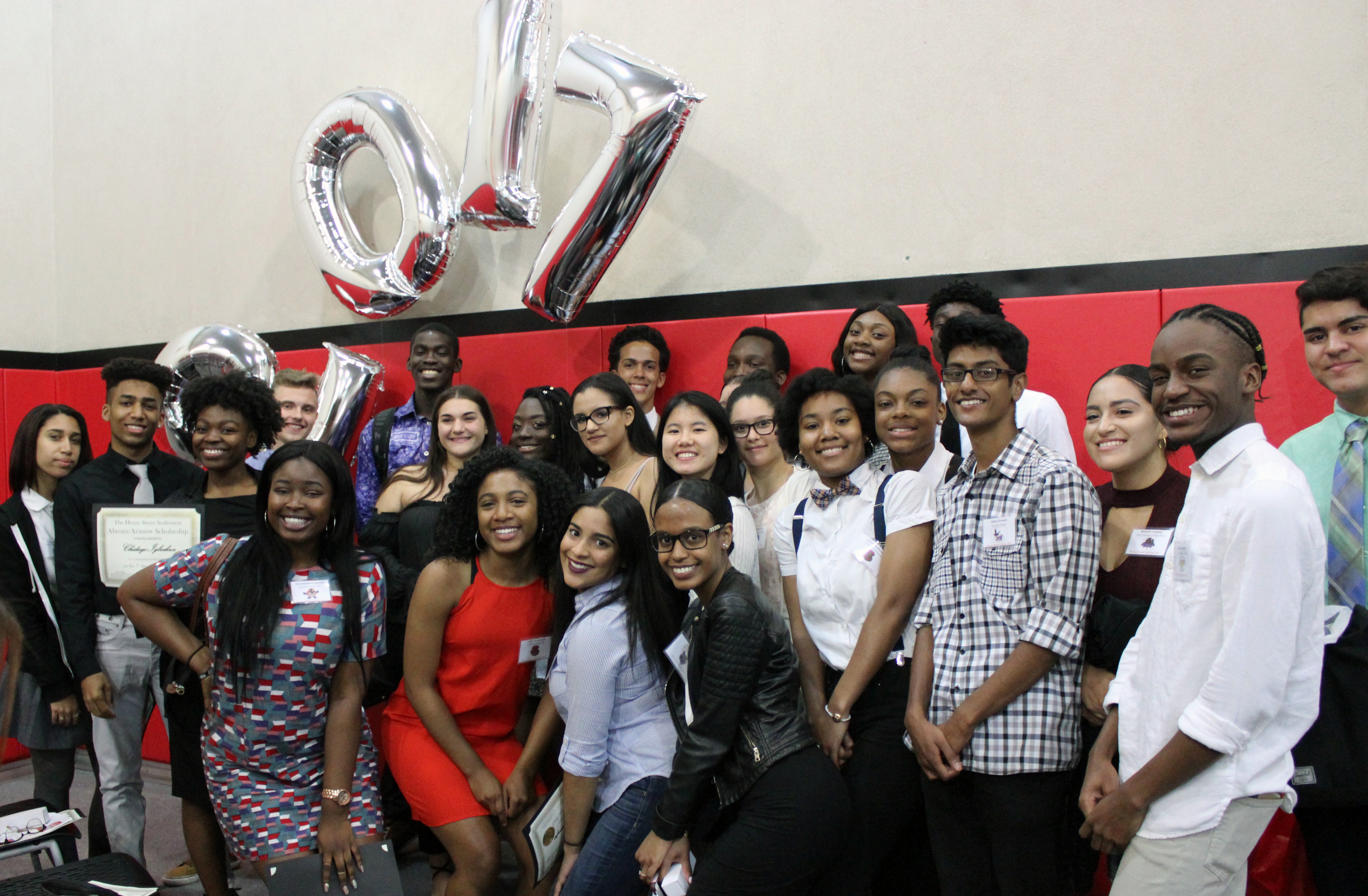 Expanded Horizons youth smile at camera with '2017' balloons
