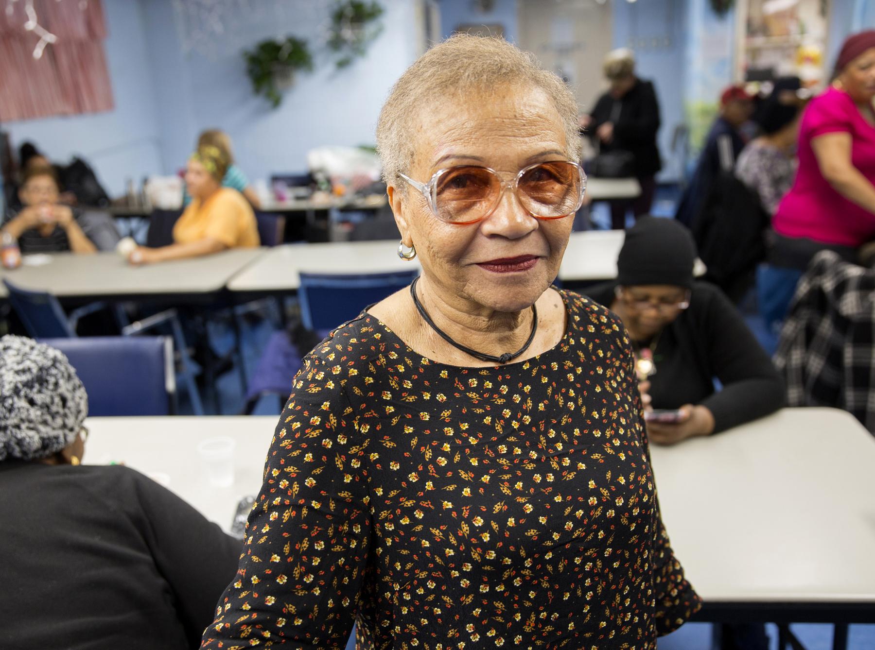 Smiling senior woman in senior center
