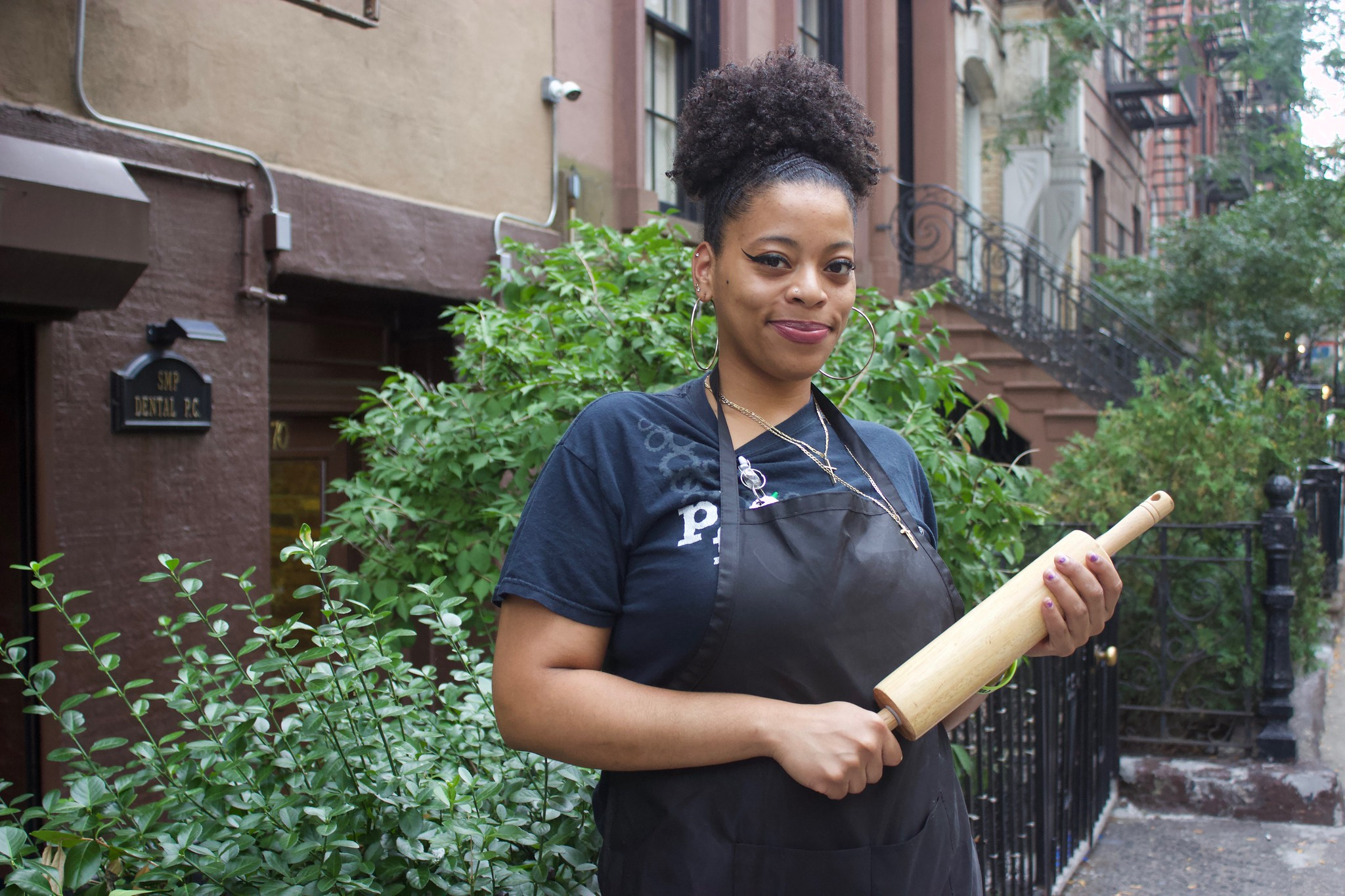 A photo of Kianna Flowers holding a rolling pin.