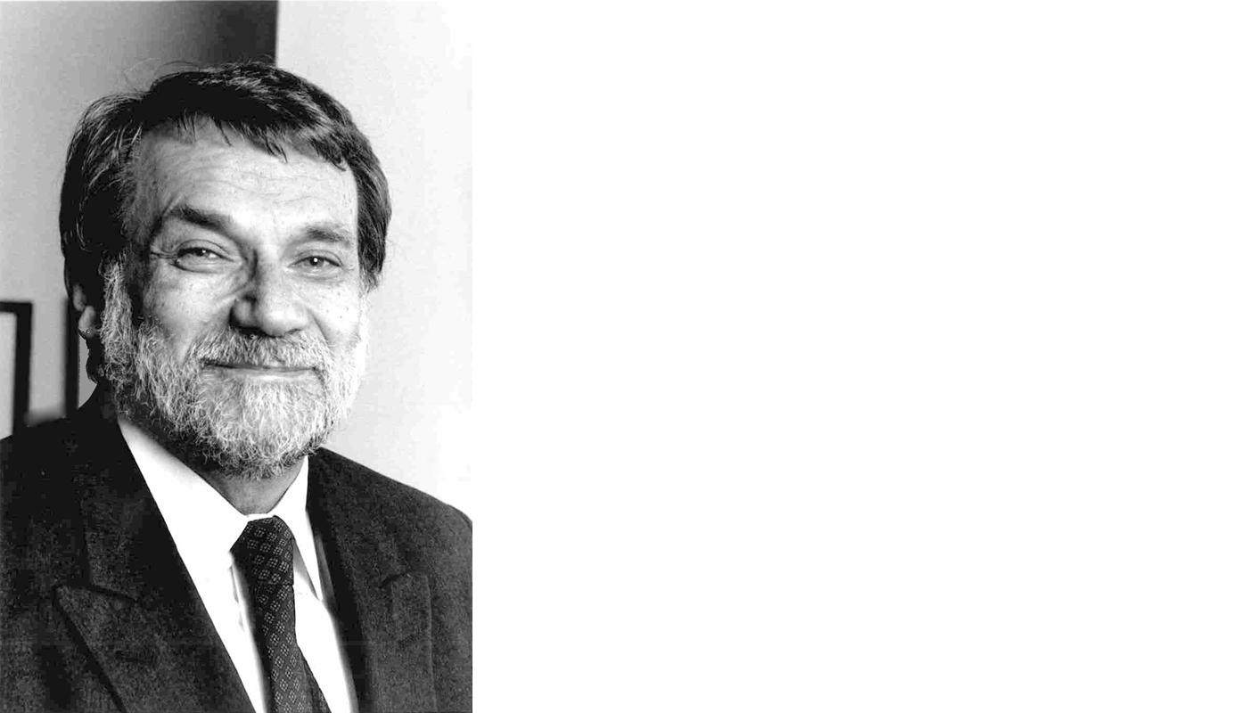 Black and white photo of Danny Kronenfeld smiling for camera