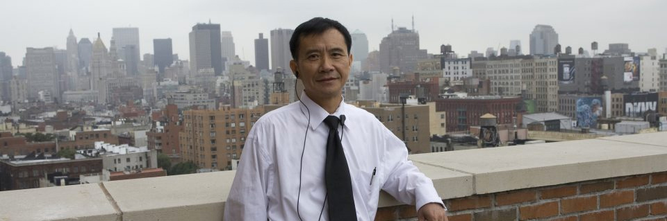 Man in tie in front of cityscape