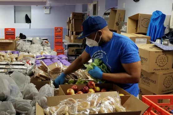 Man sorting food delivery