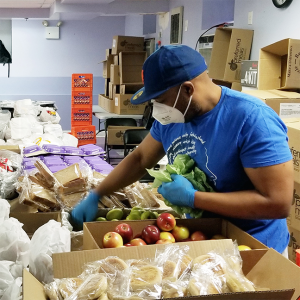 Shelter employee sorting food for residents