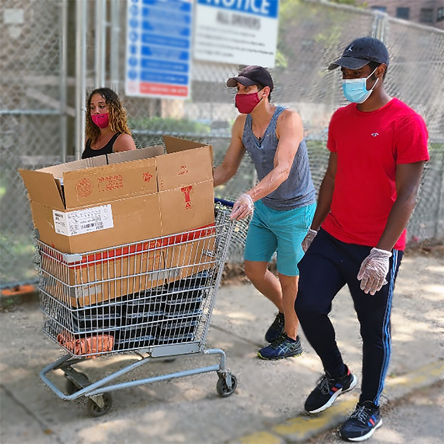 Three youth employees of the LES Mobile Market training for their delivery jobs by pushing a cart of food in the Baruch Houses.