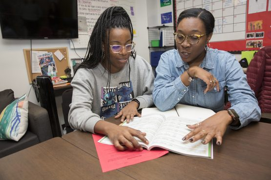 Women review materials for Middle School Success