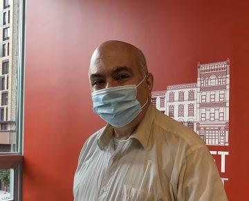 Man (David Agosta) wearing mask poses for camera