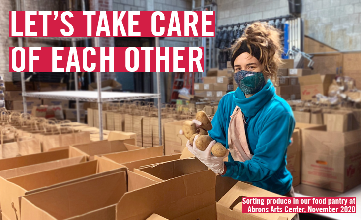 Banner that says 'Let's Take Care of Each Other' with volunteer at food pantry