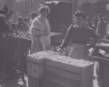 Two women at an open air market on a Lower East Side street, ca. early 1900s